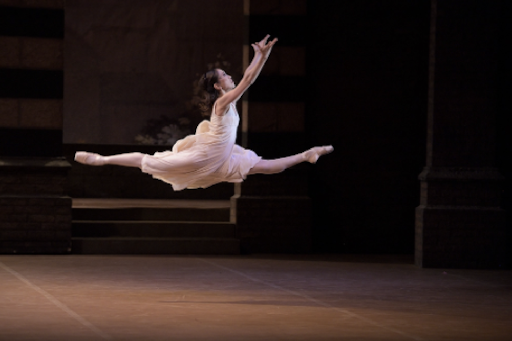 English National Opera Romeo & Juliet ballet ballerina in pink doing a leap