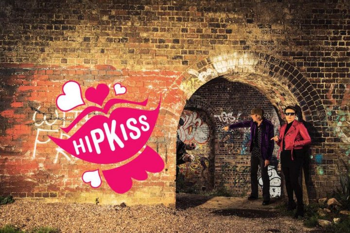 brick wall with HIPKISS in pink lips graffitied on it