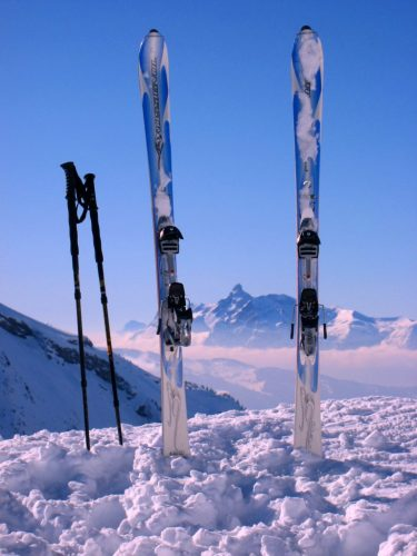 skis in the snow in the Alps