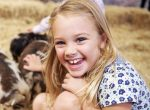 little girl with farm animals