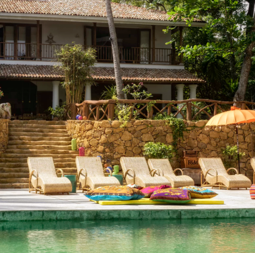 sun loungers round the pool at villa in Sri Lanka