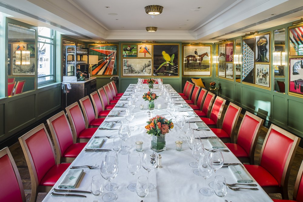 private dining room long table red leather chairs