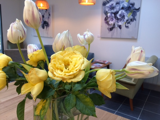 yellow flowers in reception at One Grove studio Cheltenham