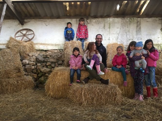 kids and parents on haystacks in France