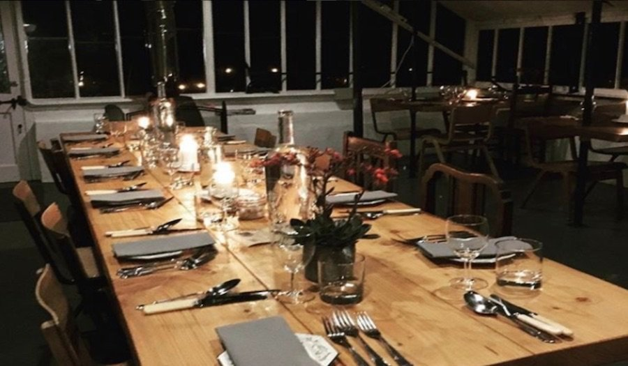 tables set for pop-up dining event
