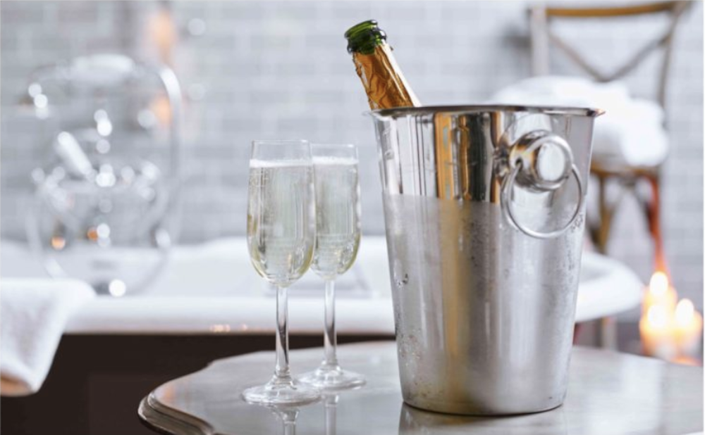 champagne in ice bucket by bath