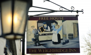 sign and lantern outside pub