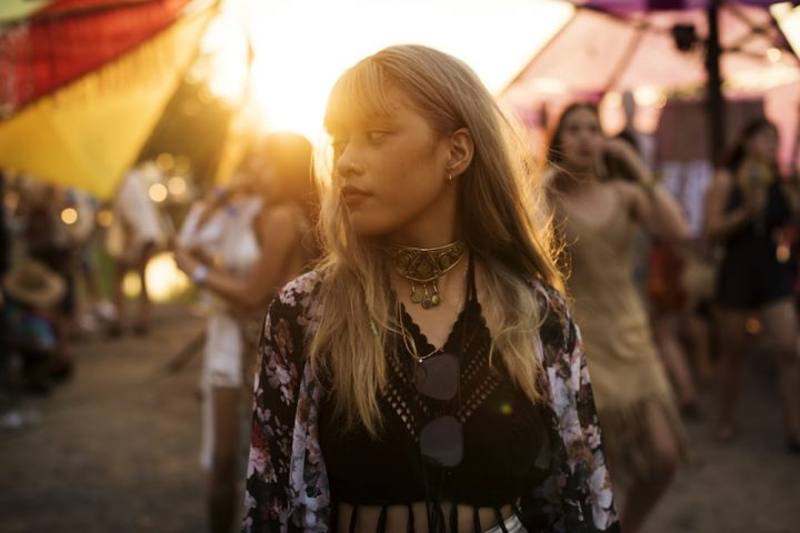 woman at a music festival sunset
