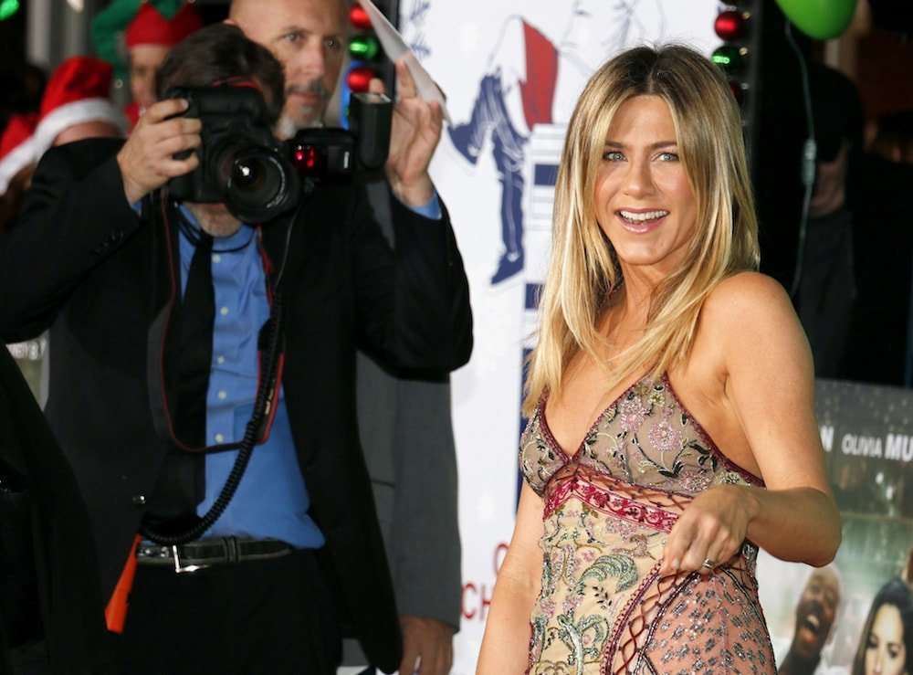 photographer taking a photo of jennifer aniston