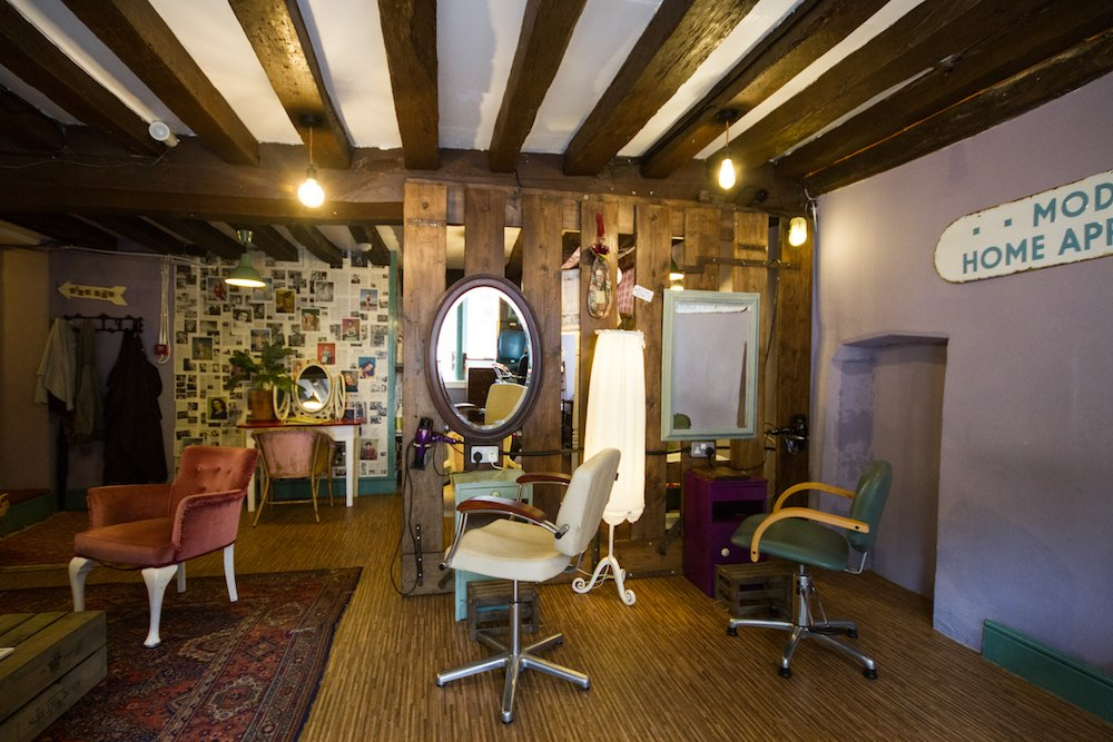 interior of Harriet's Organic Hairdressers with quirky found furniture