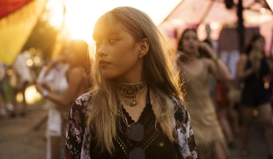girl at a festival sunset