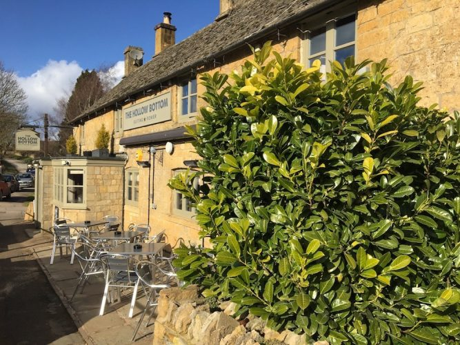 Cotswold stone pub chairs outside tree