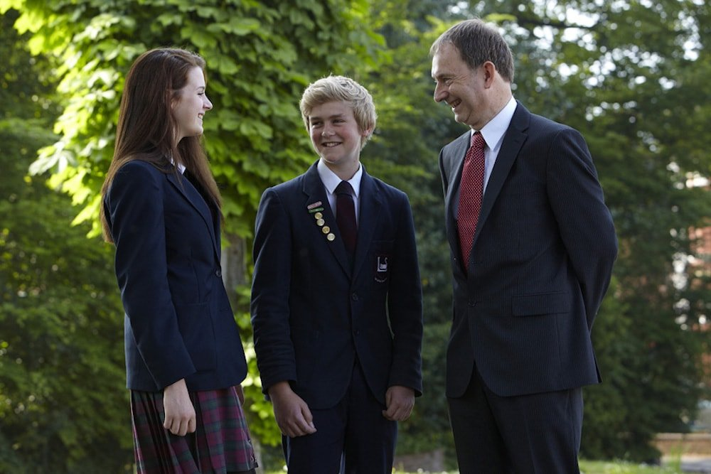 Headteacher Roger Leake with two pupils