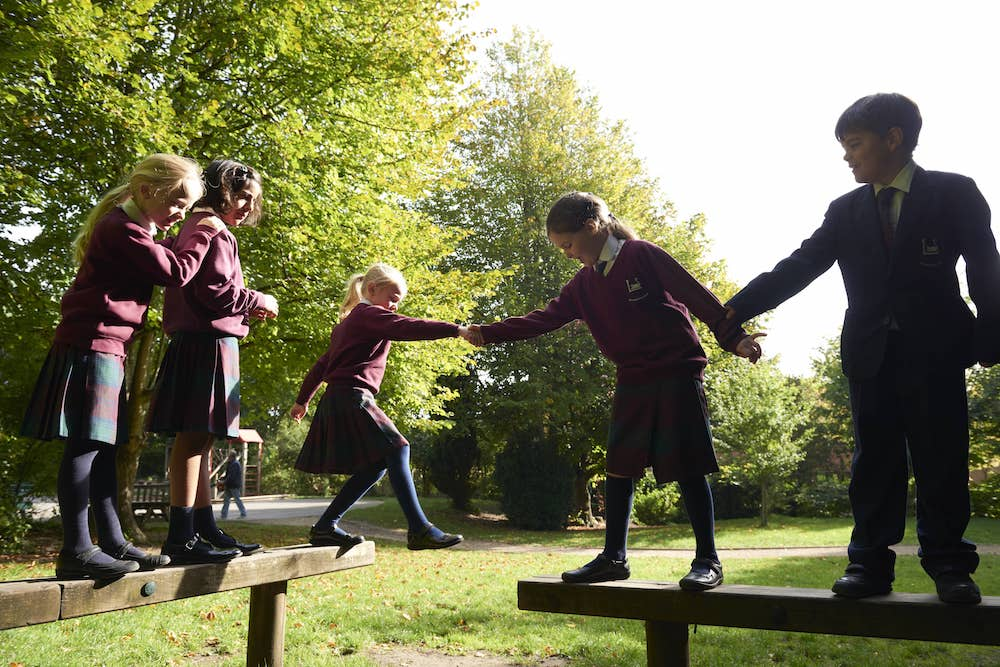 school pupils on bars in playground