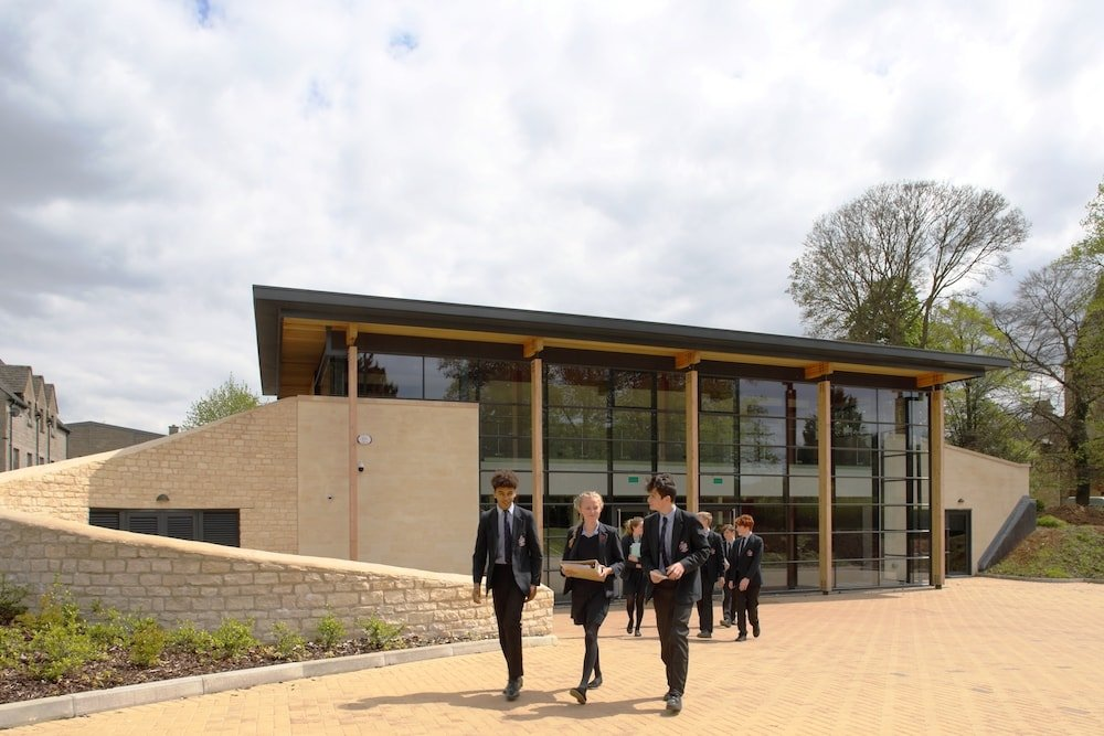 pupils walking in front of new theatre