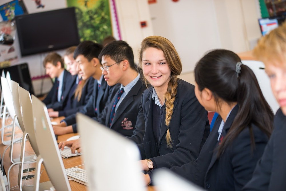 pupils in front of computers