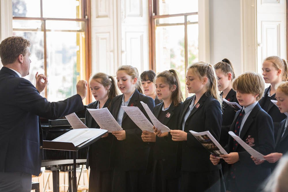 pupils in a choir singing