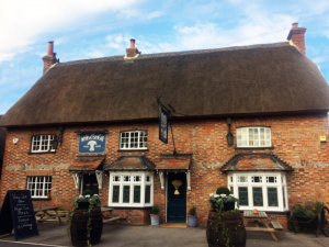 thatched roof brick pub