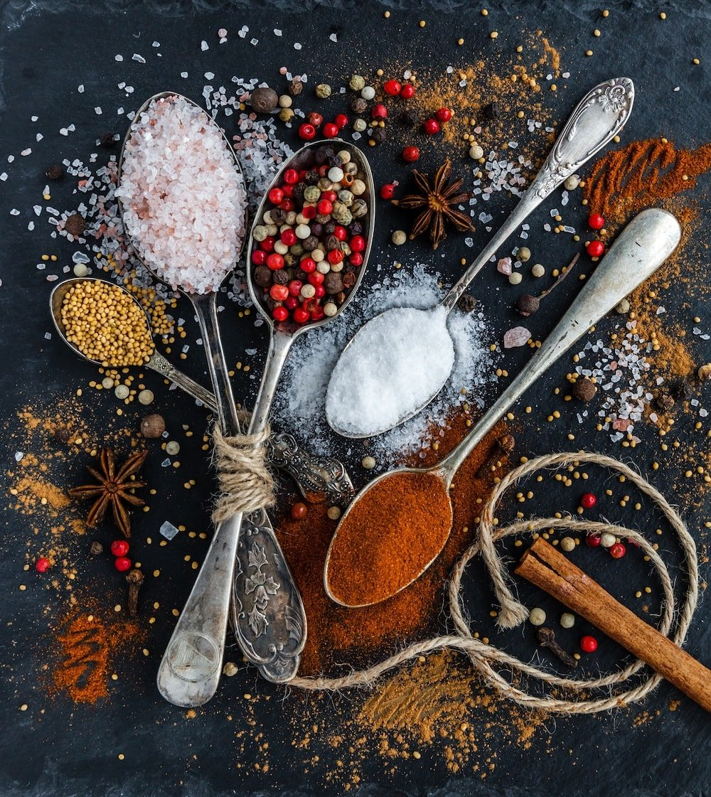 spices and seasoning in spoons cinnamon stick