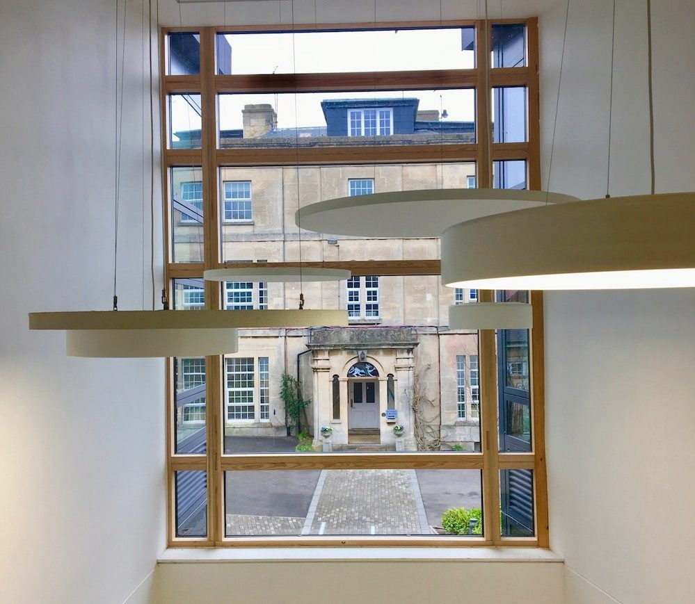 staircase in new build with view of older building