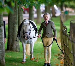 GIRL LEADING PONY
