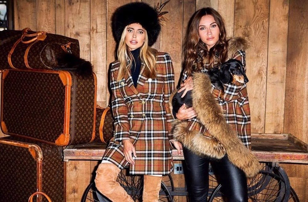 two women in check and fur hat with dog