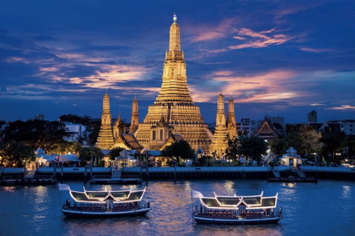 temple Thailand sunset boats blue sea and sky