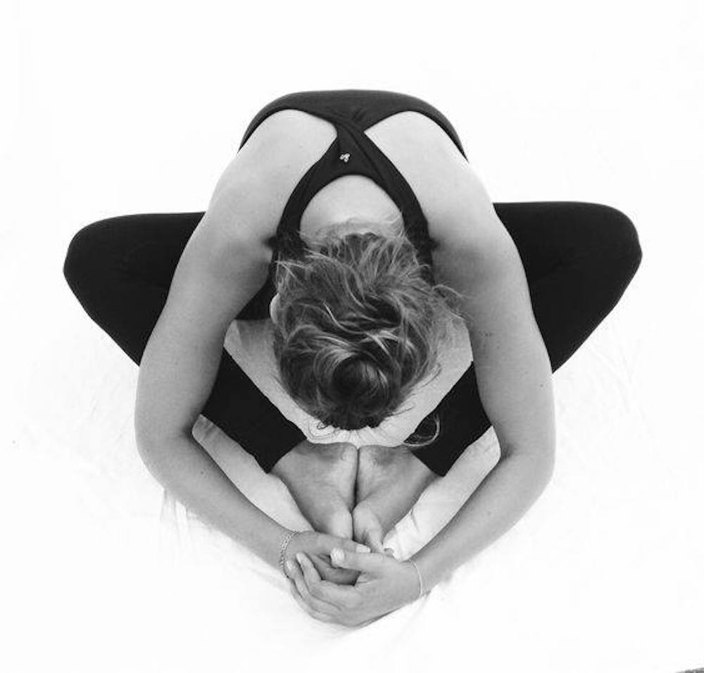 woman yoga butterfly pose