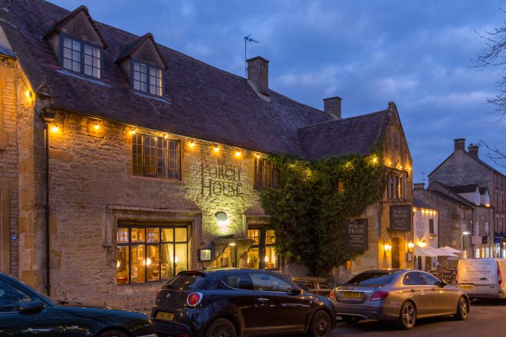 exterior pub at night cars