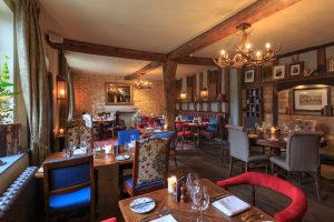 interior dining rooms blue and red chairs antlers