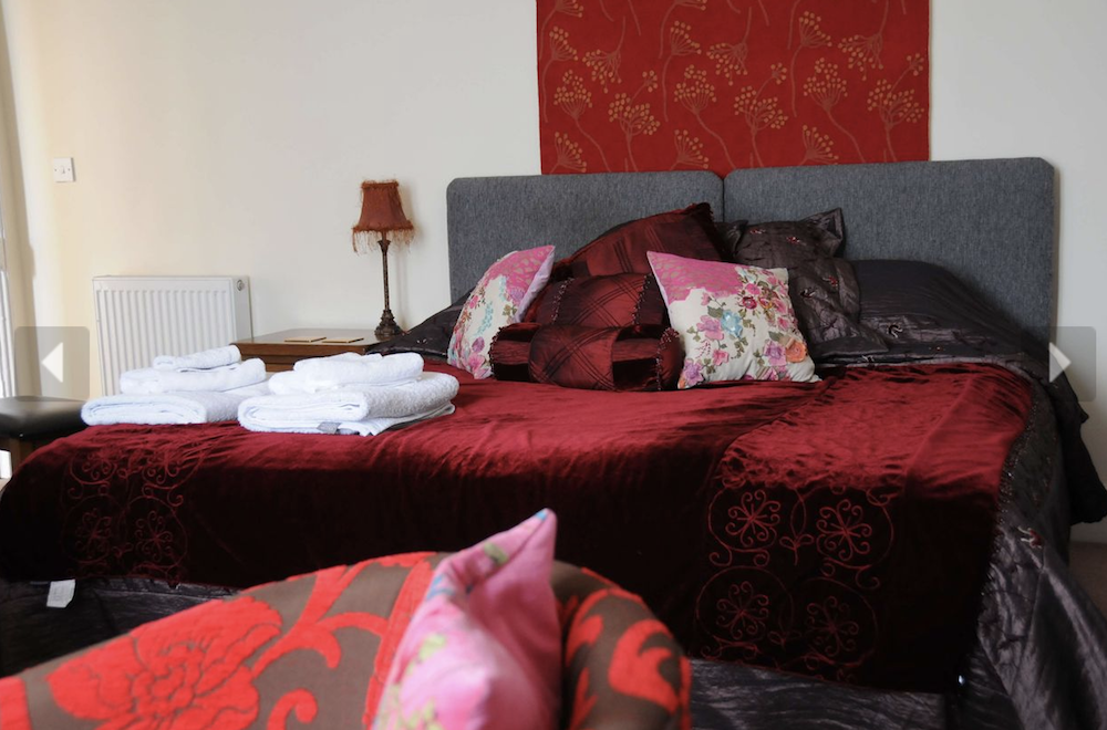 double bed red throws cushions