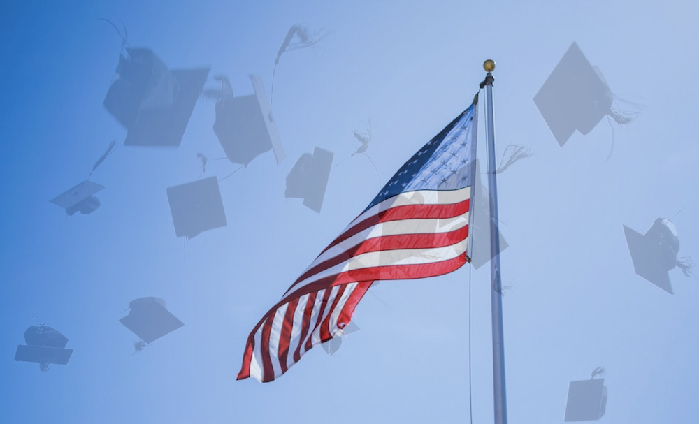 US flag, mortar boards, blue sky