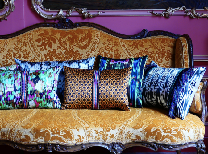 gold sofa cushions purple wall