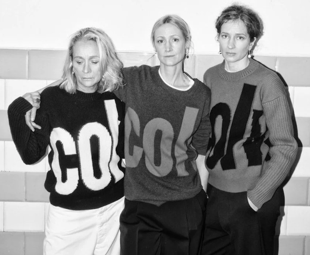 three women in jumpers