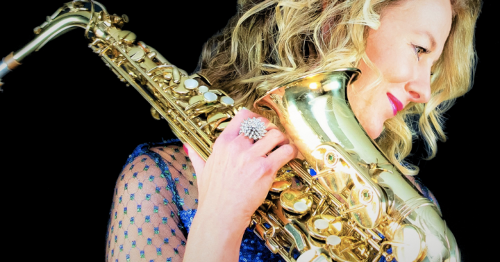 woman blonde hair saxophone