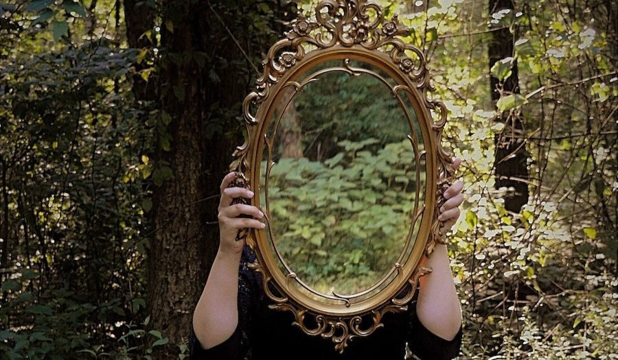 woman mirror woods