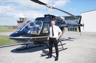man pilot helicopter